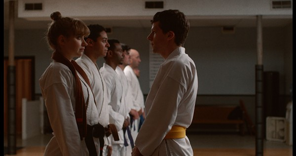 Imogen Poots and Eisenberg connect in Self-Defense. - TARO PR