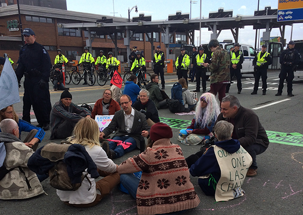Protesters demanding change sat down on the Macdonald bridge on Monday morning. - STEPHEN WENTZELL