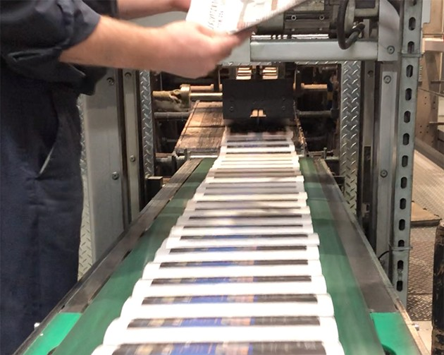 Copies of The Coast rolling off the press.