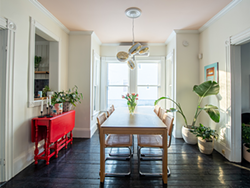 "The red table at left and its potted plant remind Manning of her grandfather, mother and father: ""There's quite a bit sentimental value in that one vignette."" - RYAN WILLIAMS"