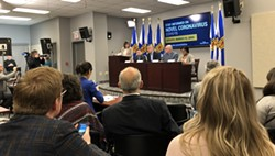 Before: The briefing room was packed Sunday, March 15 to hear about Nova Scotia's first COVID-19 cases. - THE COAST