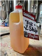 A disposable growler full of Tall Ship amber ale. - GARRISON