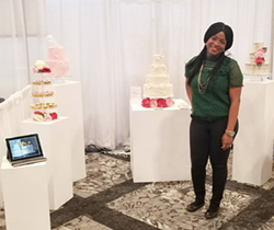 Temi Ologbenla shows off her cakes at a wedding expo. - INSTAGRAM