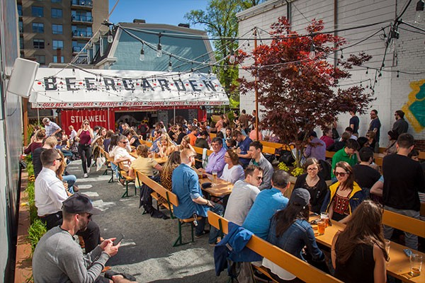 Don't get your hopes up. When premier McNeil says bars and restaurants can operate at full capacity now, he doesn't mean a return to this sort of pre-COVID, Stillwell Beergarden scene. - LENNY MULLINS