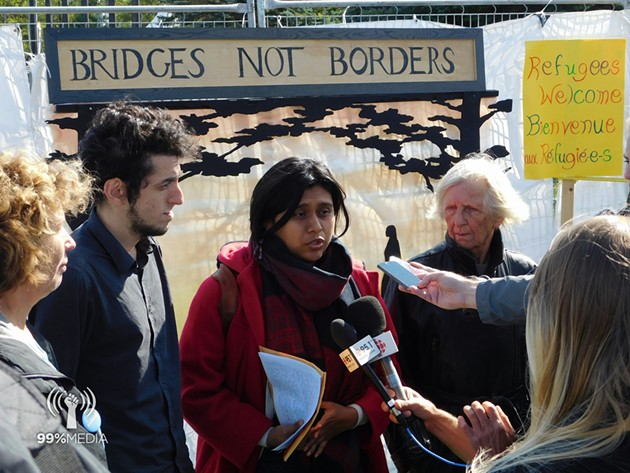 Stacey Gomez speaking at a press conference for a Refugees Welcome rally at Roxham Roxam Road, Quebec. October 1, 2017 - 99% MEDIA