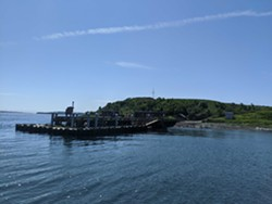 The big wharf sits atop a historic one—preserved once found by archaeologists before new construction began. - CAORA MCKENNA