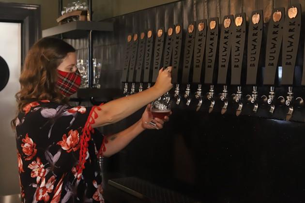 Cider House manager Shauna Krasuski pours a Bulwark Blush. - VICTORIA WALTON