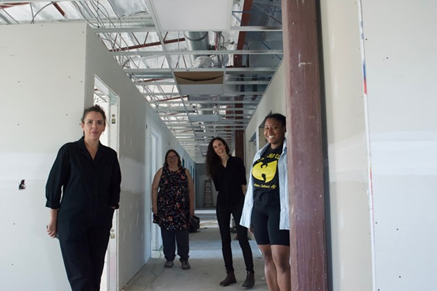 Artist Emily Falencki, artists and Wonder'neath co-founders Heather Wilkinson and Melissa Marr and artist/Wonder'neath board of directors president LaMeia Reddick took The Coast on an exclusive tour of 2482 Maynard this week. The new arts space will open sometime this fall—perhaps as early as September, they estimate. - MORGAN MULLIN PHOTO