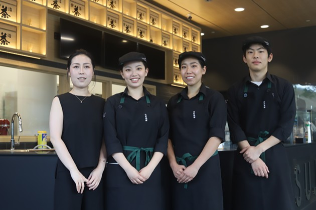 Yichun Li (left) and her team at the new Halifax location. - VICTORIA WALTON