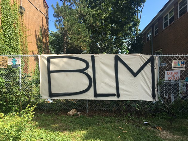 A new BLM sign hangs on the fence on Gottingen Street. - KATE MACDONALD