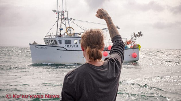 Mi'kmaw lobser harvester Colton Willis greets non-Indigenous harvesters while setting traps in St. Mary's Bay near Saulnierville, NS on September 17. - KU'KU'KWES NEWS, STEPHEN BRAKE