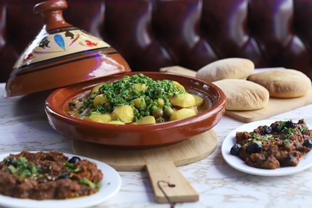 Chef Mina Haidaoui's chicken and vegetable tagine with sides of zaalouk hot eggplant salad and khobz bread. - VICTORIA WALTON