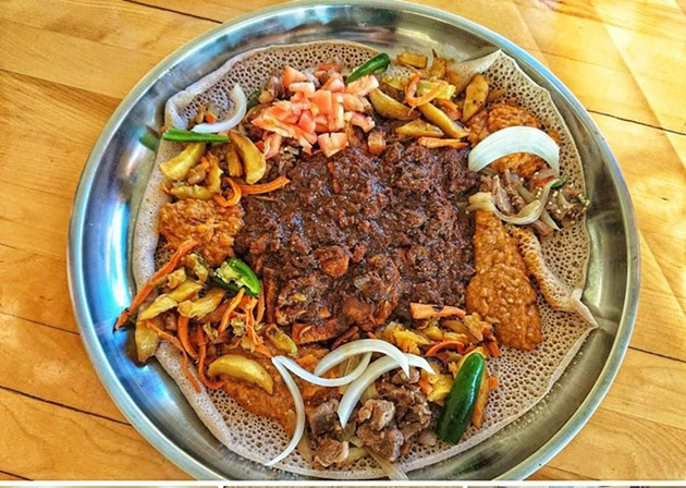 Ethiopian meat and chickpea stews atop injera bread. - ALI'S PLACE FACEBOOK
