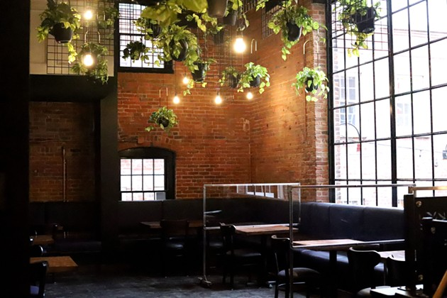 The re-design changed a lot of things, but kept the exposed brick from the 1800s. - THE COAST