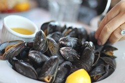The mussels are perfectly steamed, fresh and plump—with garlic butter!—at the Sou'Wester.