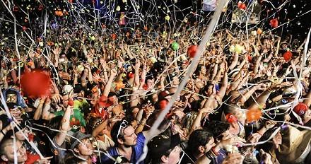 Crowds celebrate Evolve, 2014. - CHR!S SM!TH
