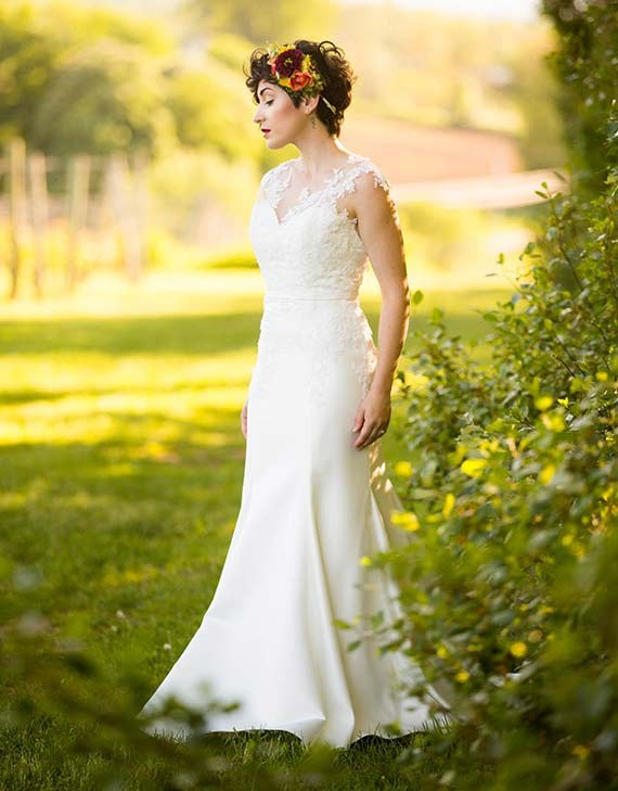 """The Charlotte: A feminine, curve-hugging silk satin gown, covered in hand-beaded floral lace appliqués. """"I wanted to create a gown that would showcase beautiful floral details that could stand on their own but also transition into the silhouette of the gown,"""" - says Tuttle. - CHANTAL ROUTHIER PHOTOGRAPHY"""