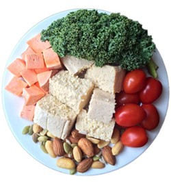 A typical day's food intake for Tucker consists of eight to 11 servings of carbs (from starchy vegetables like sweet potato) and seven to nine servings of protein (from sources like tofu, chickpeas, nuts and seeds), combined with non-starchy veggies like kale and tomatoes, all spread out based on his training schedule.