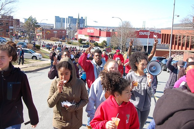 The crowd makes its way downtown. Drinks and snacks for the youth marchers were handed out by EDNA on Gottingen Street. - THE COAST