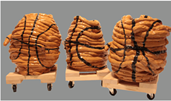 Ceramic basketballs by Lucy Marrion Pauker at the Laundry Room Gallery (see 6). - SUBMITTED