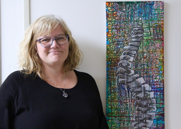 Jodi Myles, pictured here with a piece of Jordon's artwork. - KING'S COLLEGE INVESTIGATIVE WORKSHOP