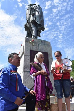 Chief Morley Googoo, Mi'kmaw elder Isabelle Knockwood and event organizer Suzanne Patles stand beneath the statue. - THE COAST