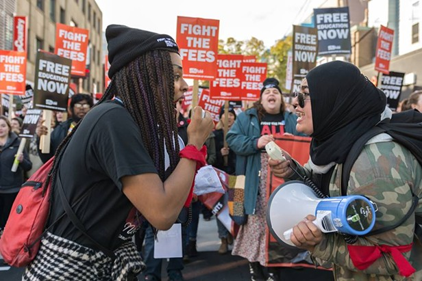 Jade Byard Peek (left) and Khan hype up their fellow students during last fall's march against tuition fees. - PATRICK FULGENCIO