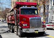 Dump trucks and social dumping