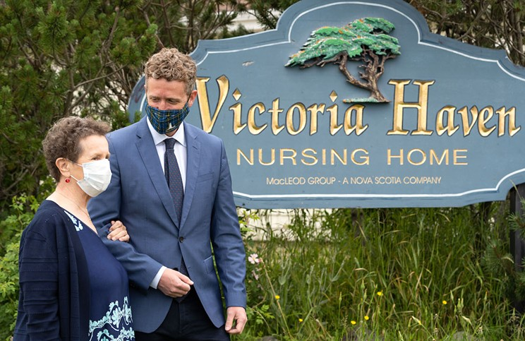 At the long-term care announcement in Glace Bay, premier Iain Rankin, right, chatted with Nina Nicholson, whose husband lives at the Victoria Haven nursing home.