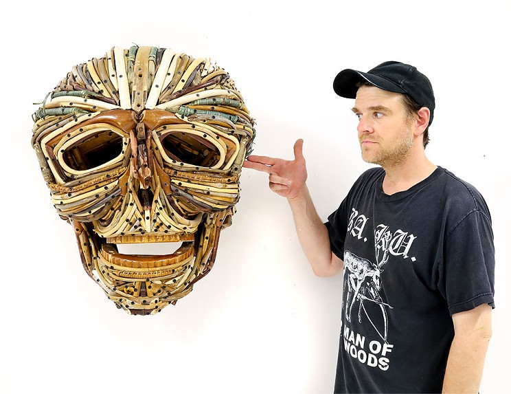 Johnston Foster created a range of sculptures, including this skull, using only broken wooden furniture.