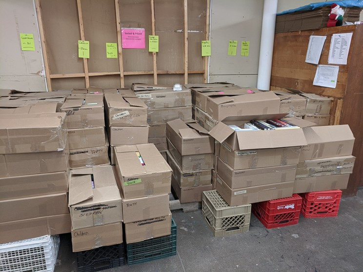 inside the book collections depot, where treasures for this weekend's sale await.
