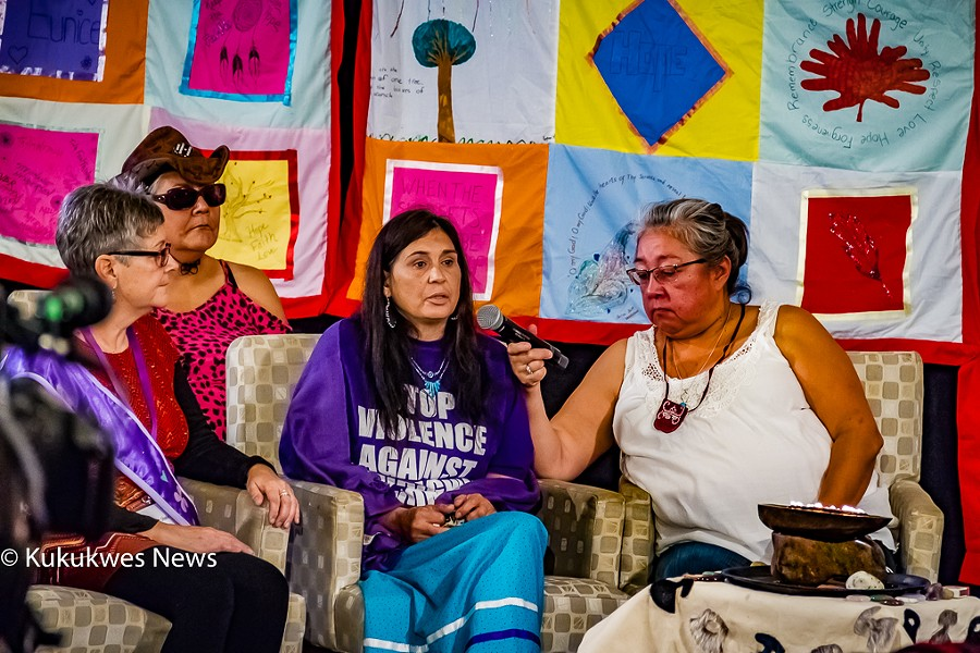 Darlene Gilbert, centre, testifies at MMIWG inquiry hearings in Membertou. - STEPHEN BRAKE
