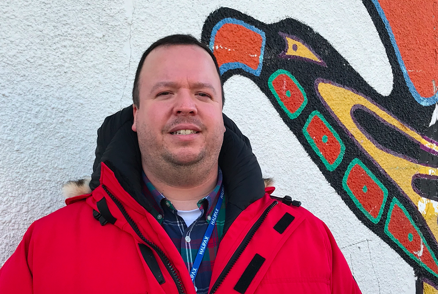 Halifax's new Indigenous advisor Wyatt White stands in front of the Mi'kmaw Native Friendship Centre on Gottingen Street. - THE COAST