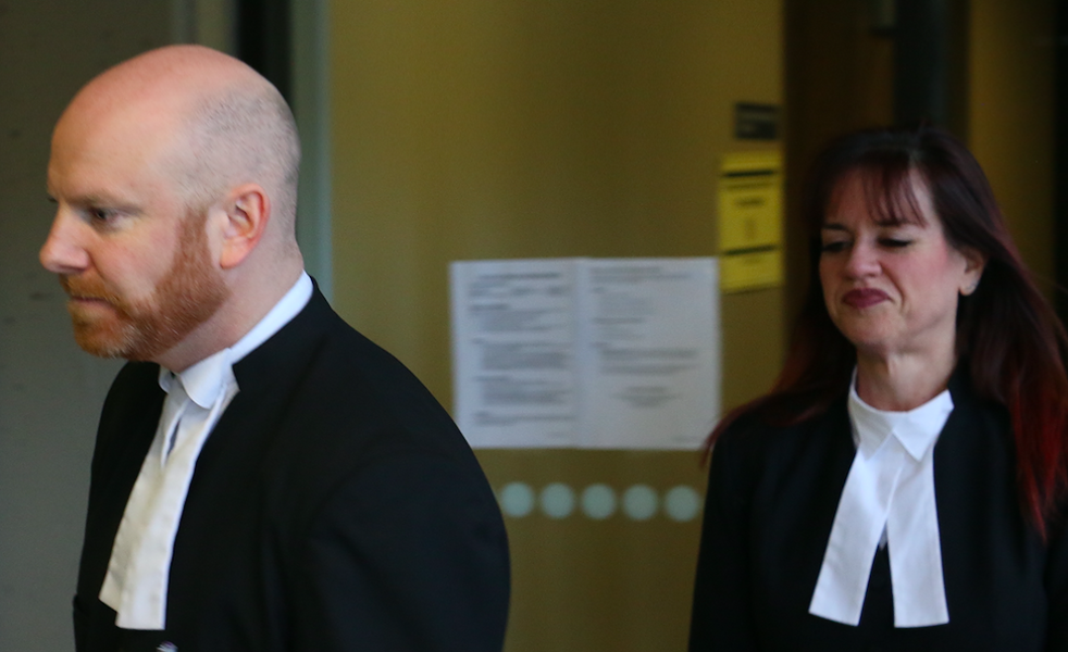 Crown attorneys Steve Degen and Melanie Perry leaving court on April 6. - KIERAN LEAVITT