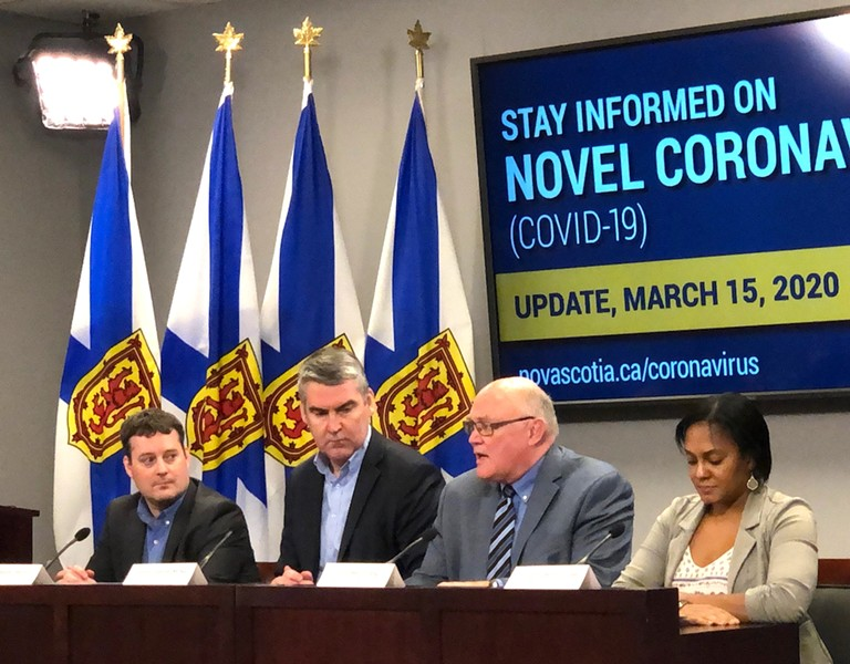 Nova Scotia officials, from left, health minister Randy Delorey, premier Stephen McNeil, chief and deputy chief medical officers of health Robert Strang and Gaynor Watson-Creed, at Sunday's COVID-19 press conference. - THE COAST