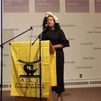 Project coordinator Nzingha Millar speaks at last week's screening.