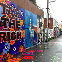 """Tax The Rich"" mural by Megan Wilson on Clarion Alley San Francisco."