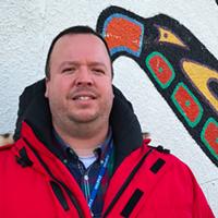 Halifax's new Indigenous advisor Wyatt White stands in front of the Mi'kmaw Native Friendship Centre on Gottingen Street.