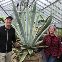 Sheldon Harper, the gardener who discovered the bloom and Heidi Boutilier.
