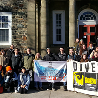 Activists celebrate last winter after the Dalhousie board of governors votes to look into divestment.