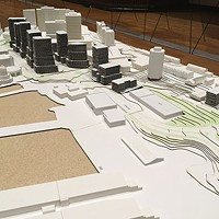 A very-white model of the downtown with the new Cogswell district in place.
