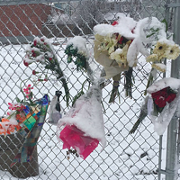 """A makeshift memorial set up on Gottingen Street for Thomas """"Willard"""" Comeau, who was killed last week by a truck driver."""