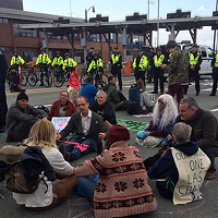 Protesters demanding change sat down on the Macdonald bridge on Monday morning.