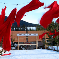 Red dresses hung along the road near the Unist'ot'en healing centre in BC.