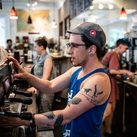 Barista Jude Kay pours a hot one.