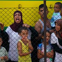 Syrian refugees striking at the platform of Budapest Keleti railway station.