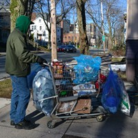 Greg, a regular recyclables collector, pushes his cart up Jubilee Road.