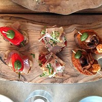 A plate of tuna, pork belly and charred octopus pintxos.