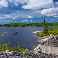 Canoeists inside the Blue Mountain-Birch Cove Lakes wilderness area.