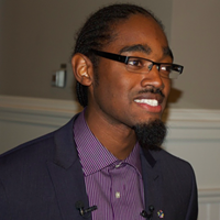 Lindell Smith, speaking to reporters on Tuesday at City Hall.